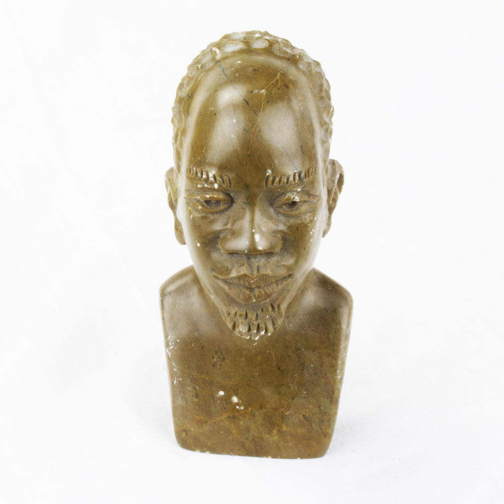Hand carved dark green stone sculpture of an african man s