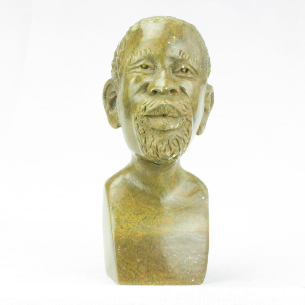 Hand carved stone sculpture of an african man head